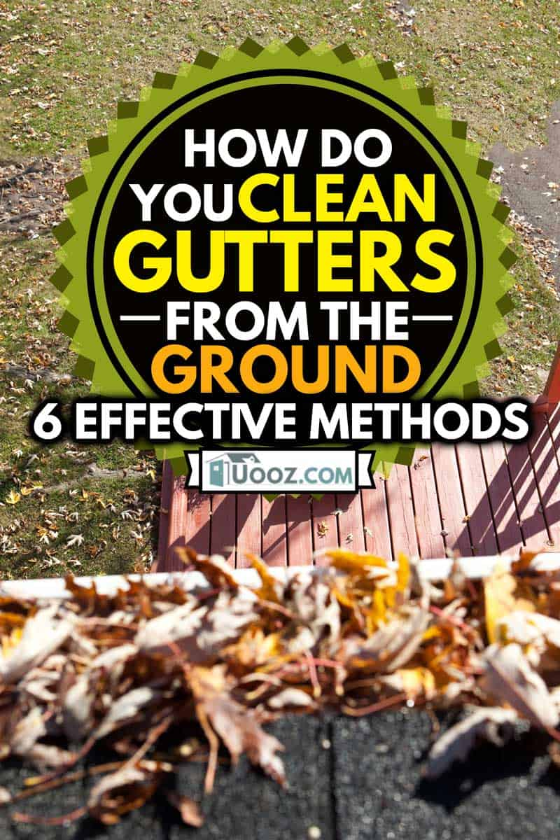 A view from a rootop of a man sweeping fall leaves, How Do You Clean Gutters From The Ground? [6 Effective Methods]