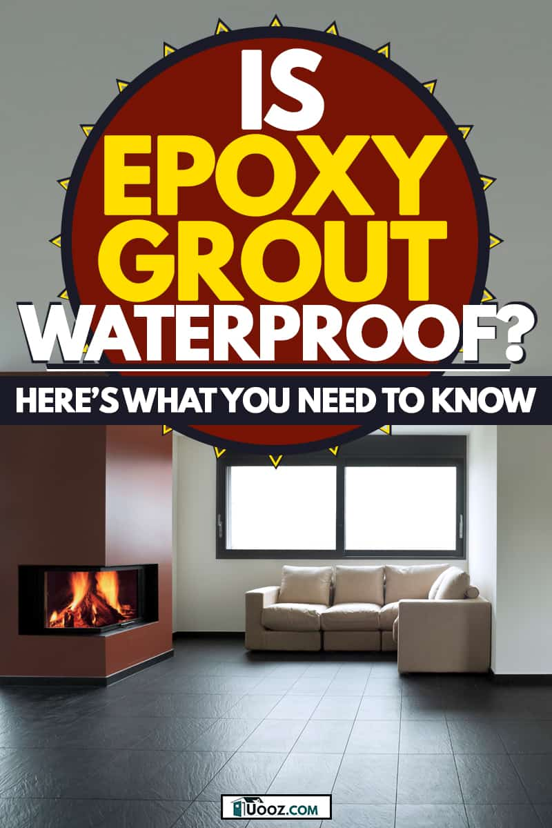 A spacious and minimalist designed living room with black tiles and a fireplace on the middle, Is Epoxy Grout Waterproof? Here's what you need to know