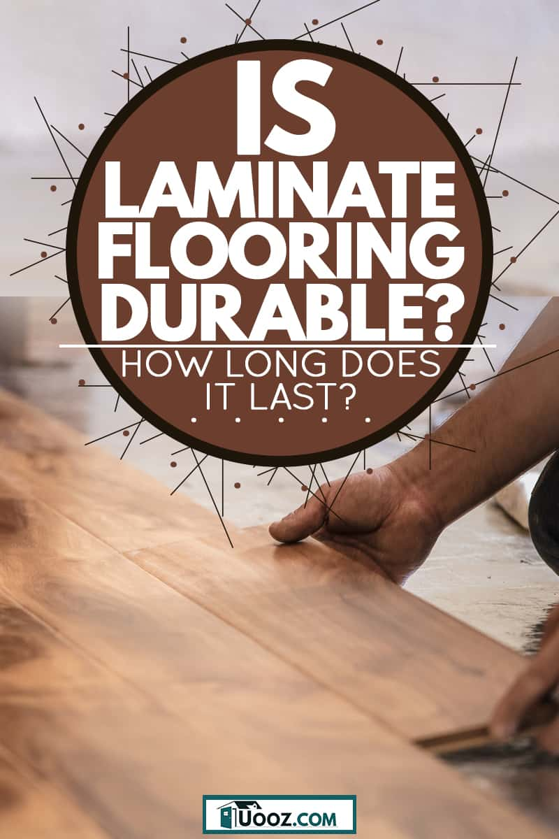 A man installing wooden flooring panels on the floor, Is Laminate Flooring Durable (How Long Does It Last?)