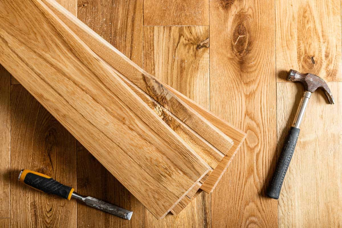 The process of house renovation with changing of the floor from carpets to solid oak wood, Should Hardwood Floors Match Throughout The House?