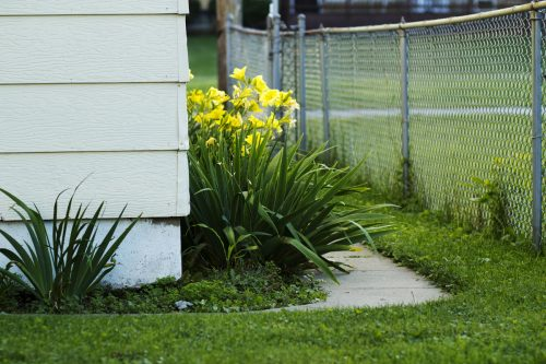 Should A Chain Link Fence Touch The Ground? [And how deep should posts go?]