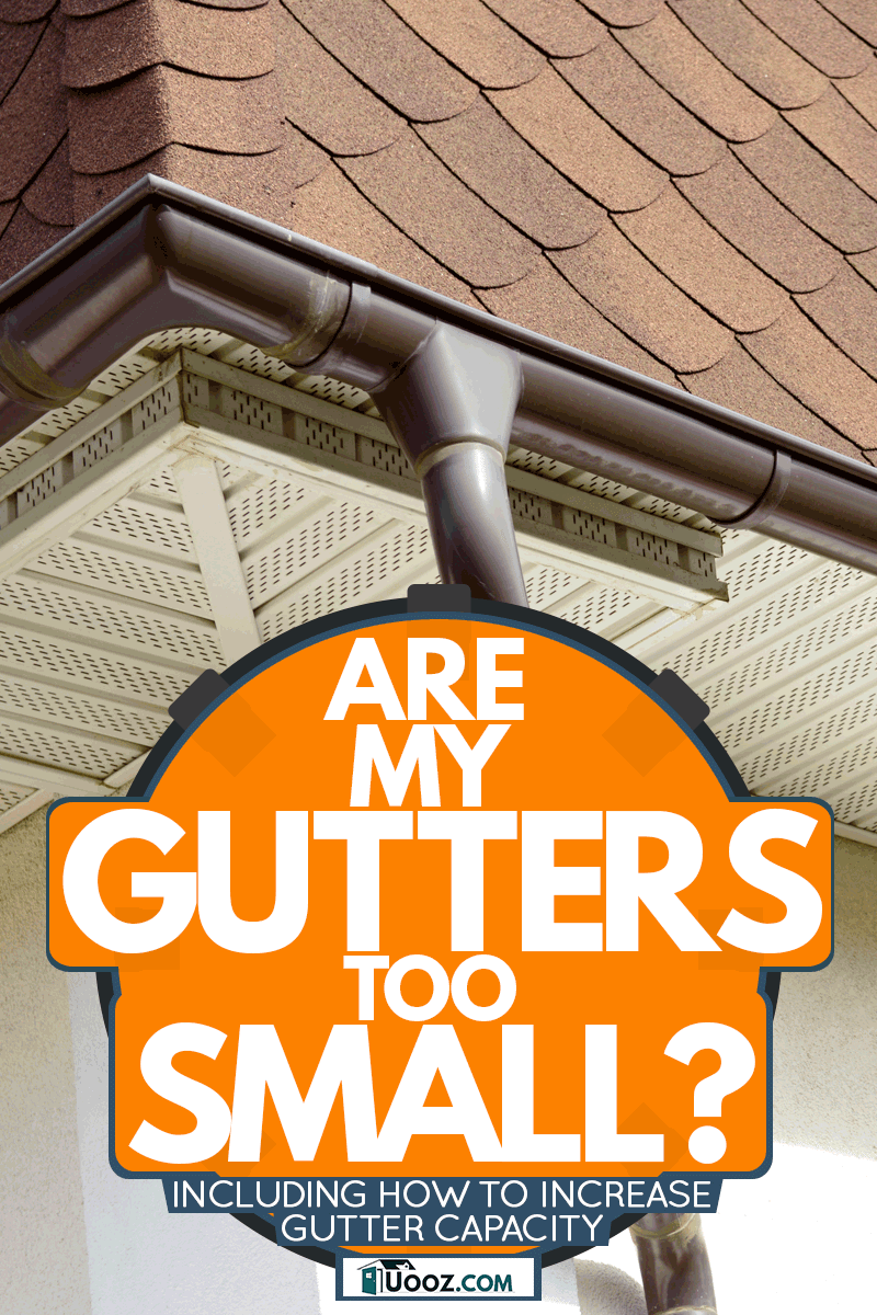 A house with asphalt shingles and a small steel gutter with a galvanized iron down spout, Are My Gutters Too Small? (Inc. How To Increase Gutter Capacity)