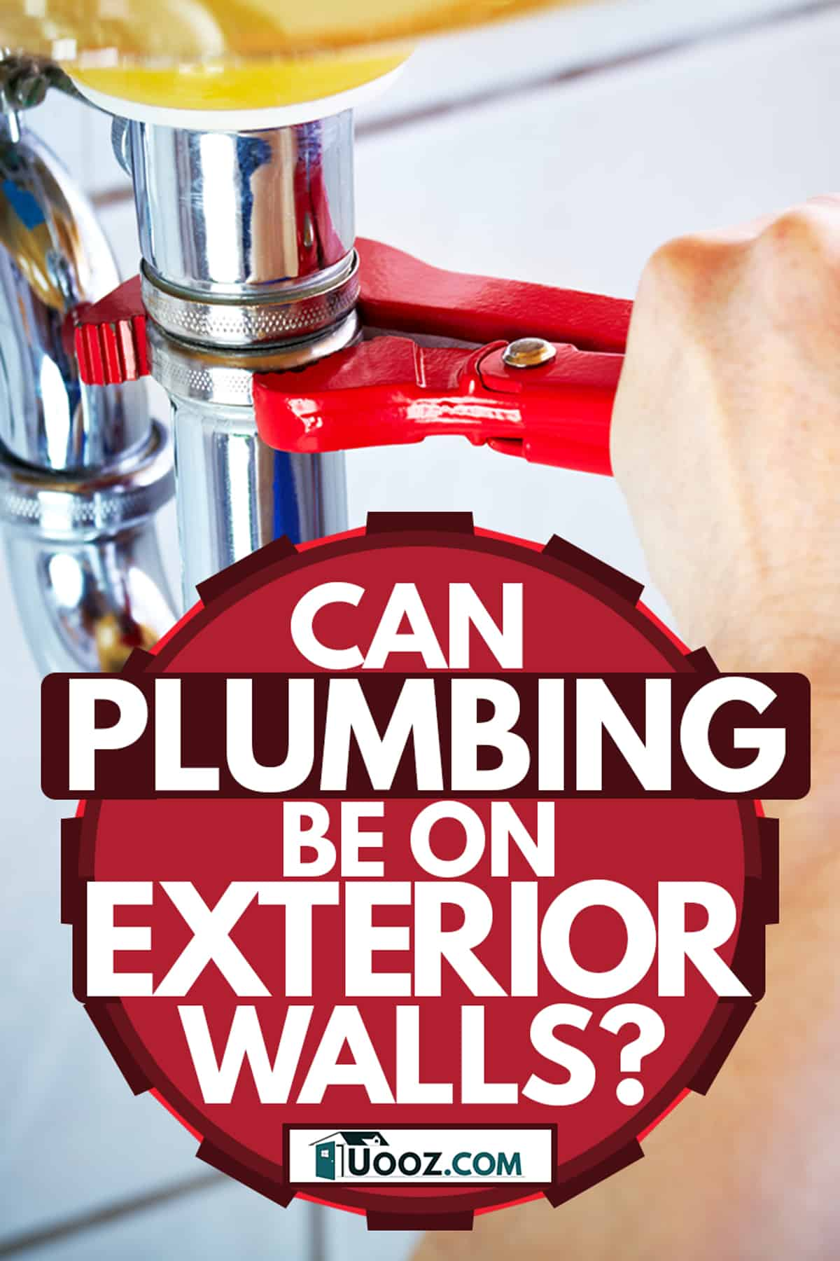 A plumber adjusting the G.I P-trap pipe using a pipe wrench, Can Plumbing Be On Exterior Wall?