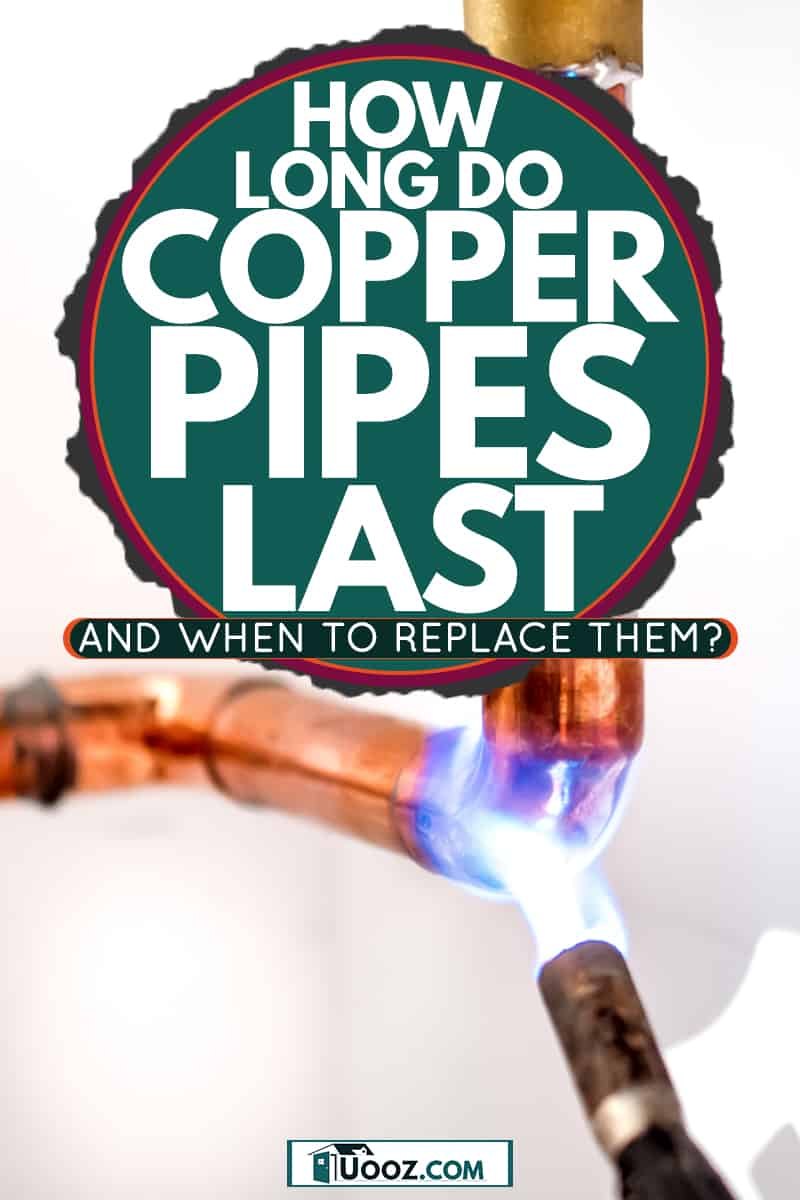 A plumber using a blow torch to secure a copper pipe in a water lne, How Long Do Copper Pipes Last And When To Replace Them?