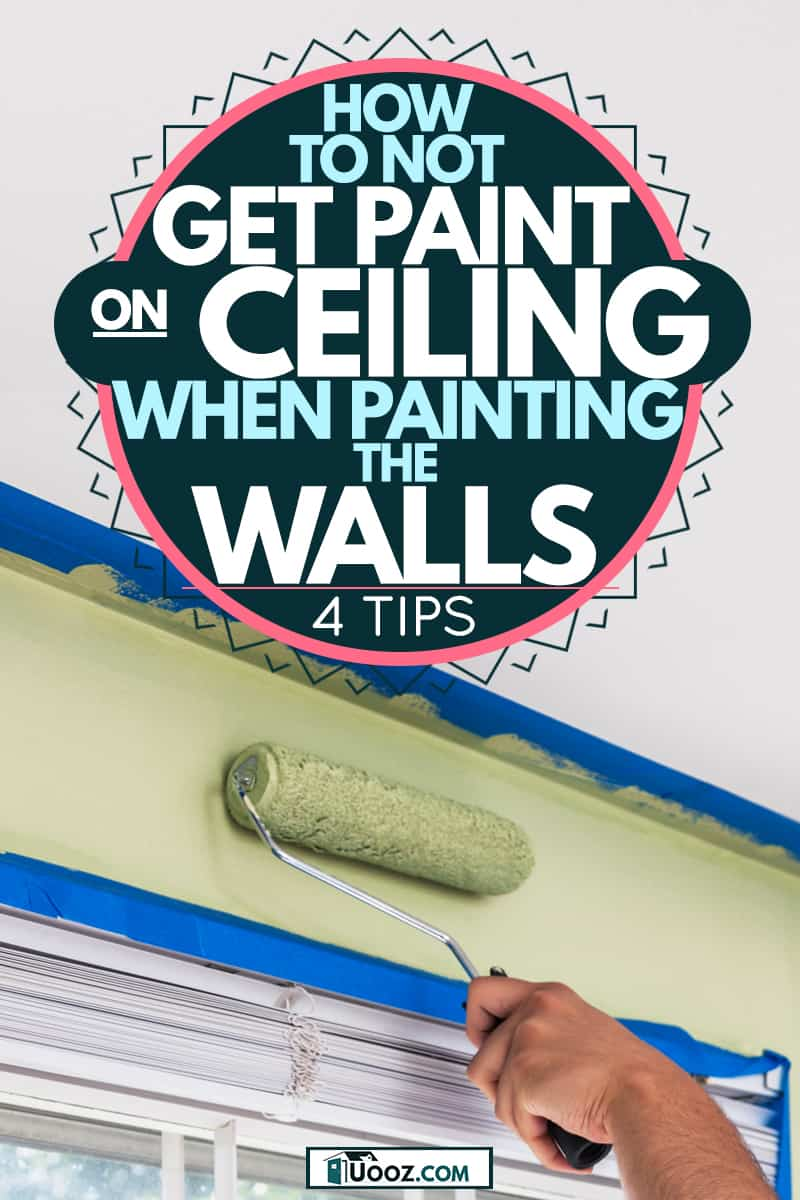 A painter painting with a light green color to the wall and taped the ceiling corners to avoid smudging paint on it, How to Not Get Paint on Ceiling When Painting the Walls [4 Tips]