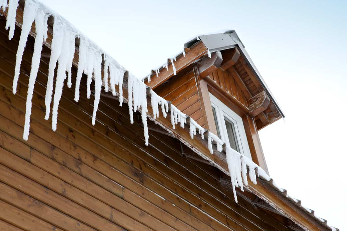 Icicles forming on the sides of the roofing