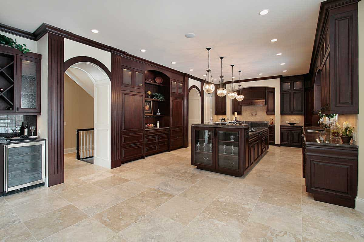 Kitchen with dark wood cabinetry and ceramic tile