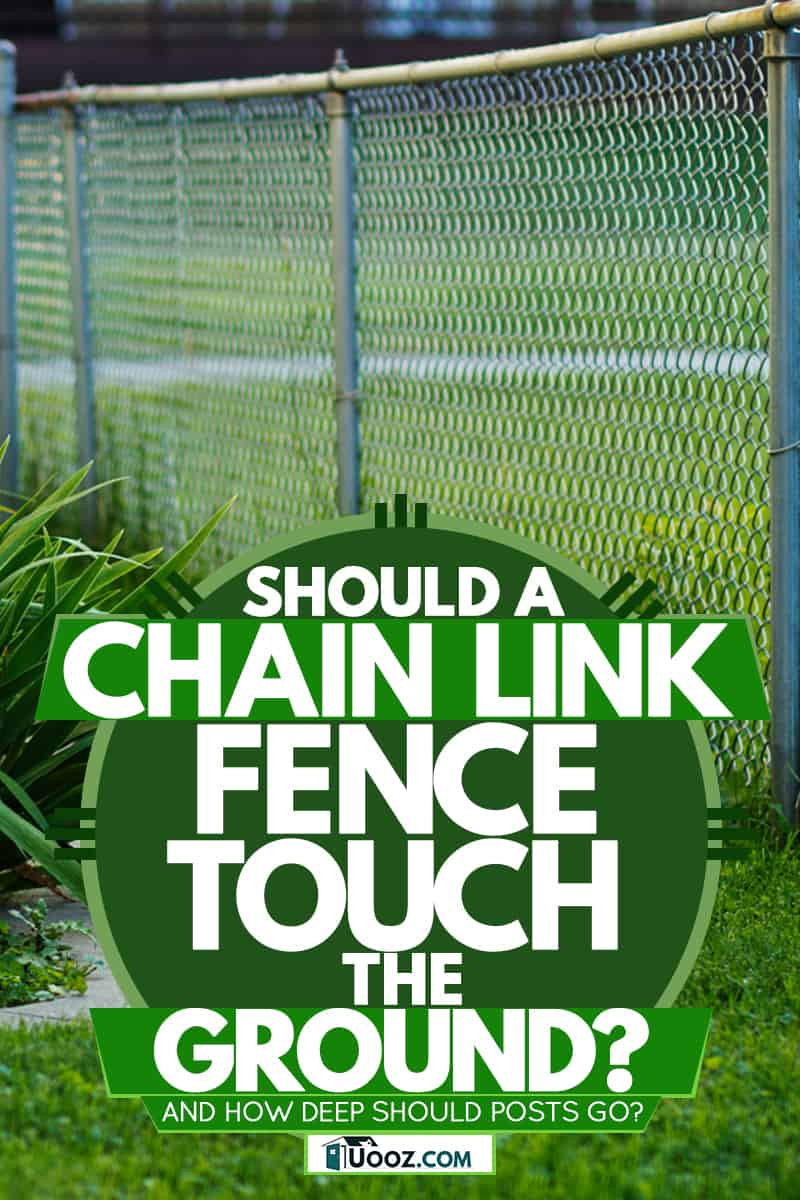A chain link fence on the side of the house, Should A Chain Link Fence Touch The Ground? [And how deep should posts go?]