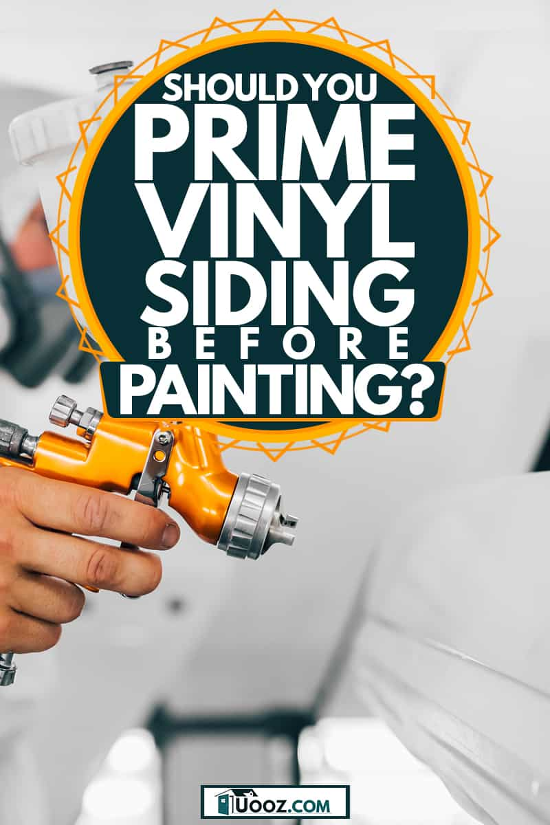 A painting specialist using an airbrush to paint the wall, Should You Prime Vinyl Siding Before Painting?