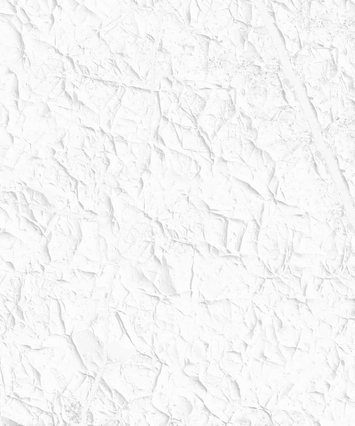 A close up of a white painted stucco wall texture with ridges for use as a background or design element