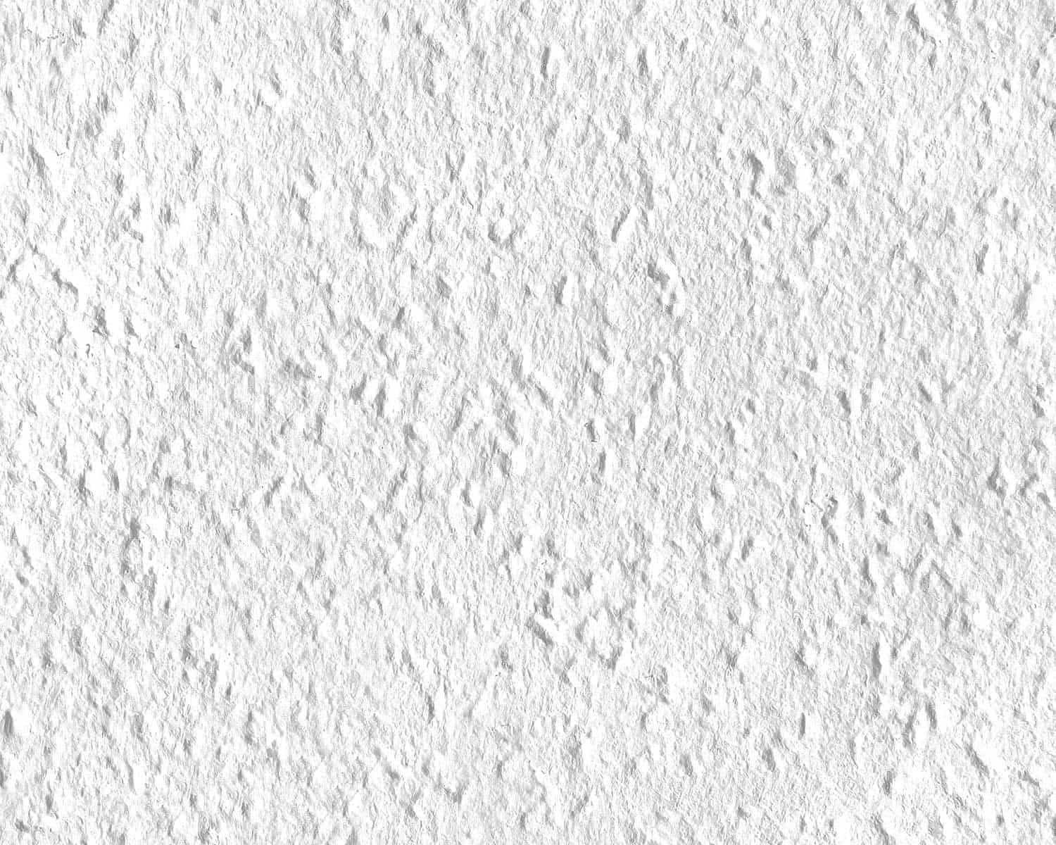 A close up of painted white texture woodchip wallpaper