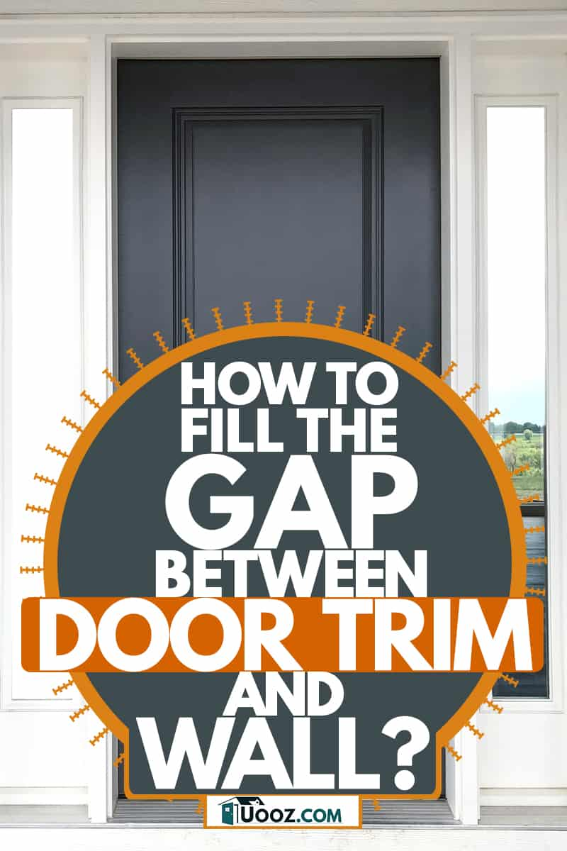 A dark gray colored door with a white painted door frame and decorative wooden vinyl on the porch, How to Fill The Gap Between Door Trim And Wall?