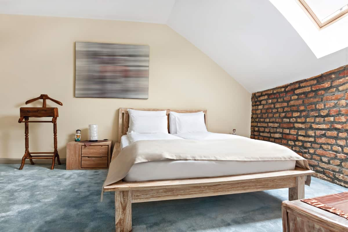 Luxurious modern loft bedroom interior with twin bed