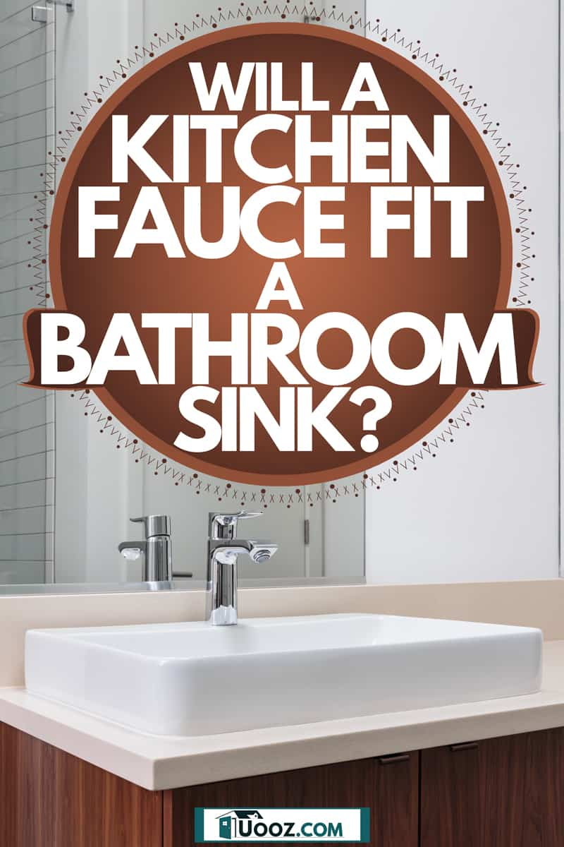A modern bathroom with a white sink and wooden cabinets on the bottom, Will A Kitchen Faucet Fit A Bathroom Sink?