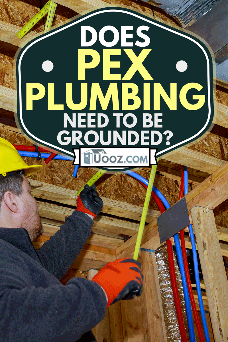 Male builder measuring plastic pipes with new home construction in hot and cold blue and red pex pipe layout in pipes exposed beams, Does PEX Plumbing Need To Be Grounded?