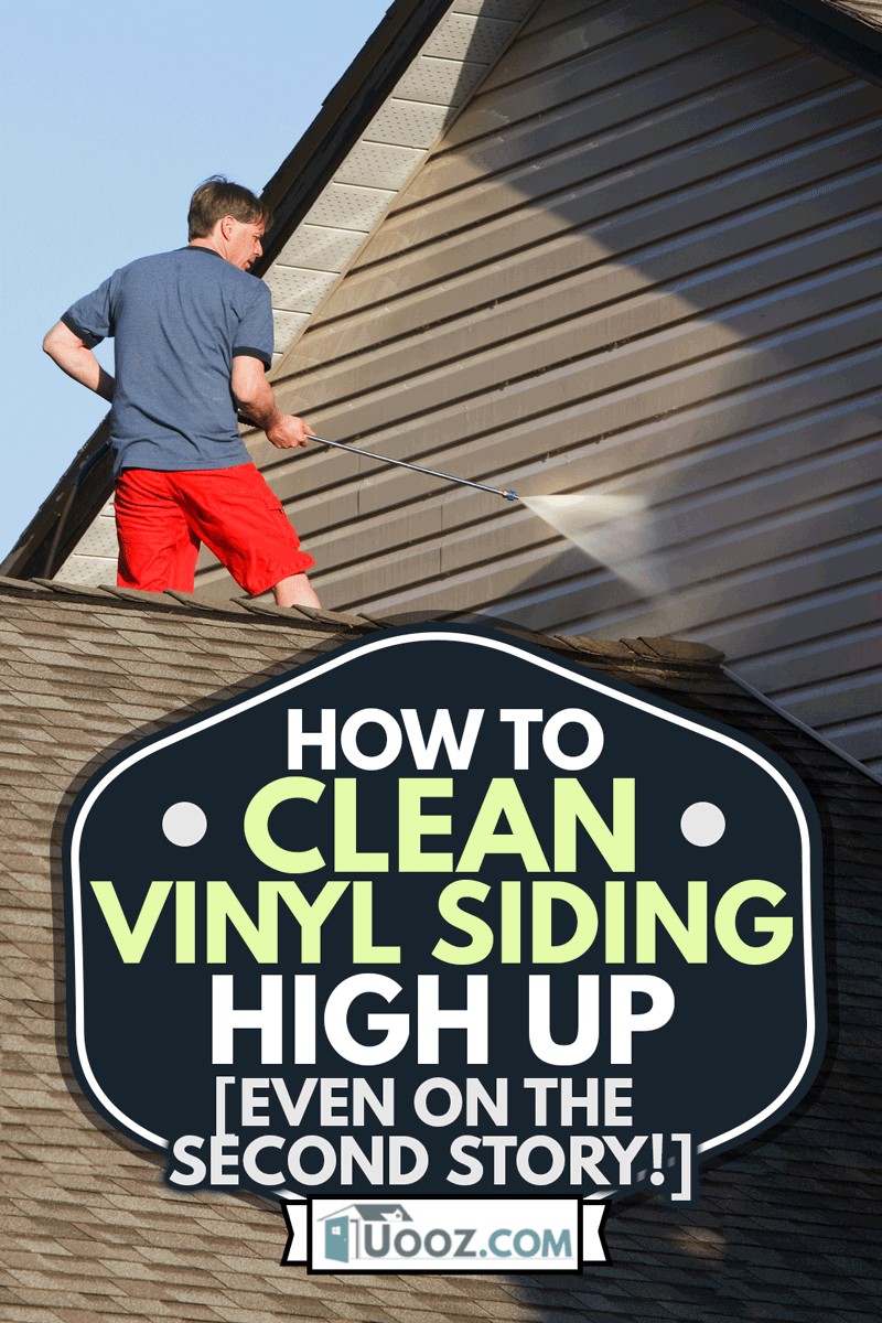 Man using pressure washer to clean his house, How To Clean Vinyl Siding High Up [Even on the Second Story!]