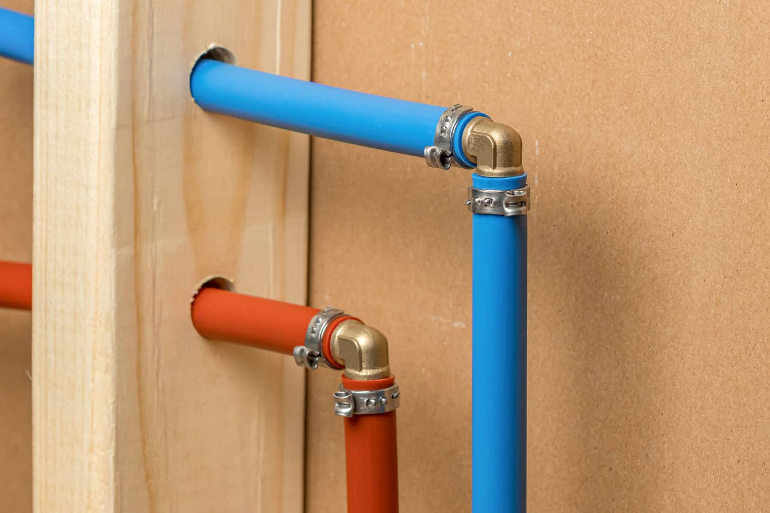 Pex plastic water supply plumbing pipe in wall of house
