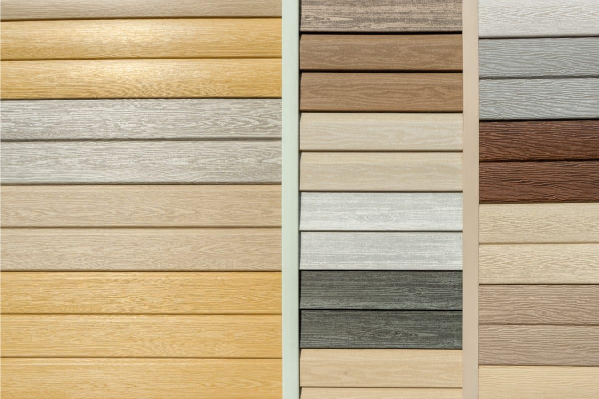 Vinyl siding with imitation wood texture in bright palette of colors