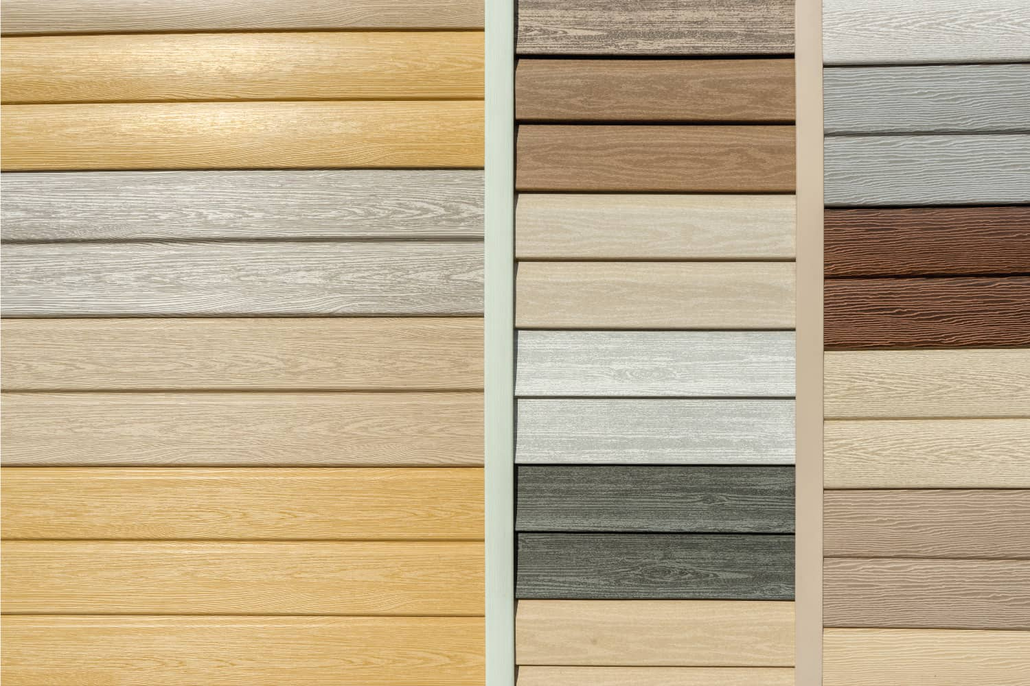 Vinyl siding with imitation wood texture in bright palette of colors. Plastic wall covering for exterior decoration of house