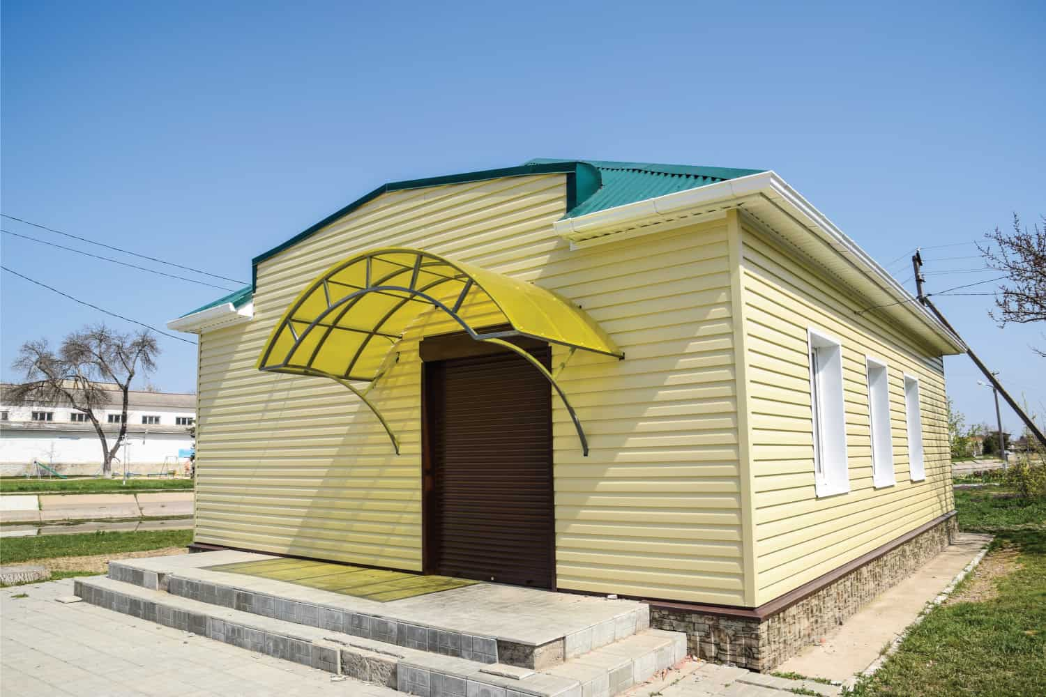 House under the sun, lined with plastic siding