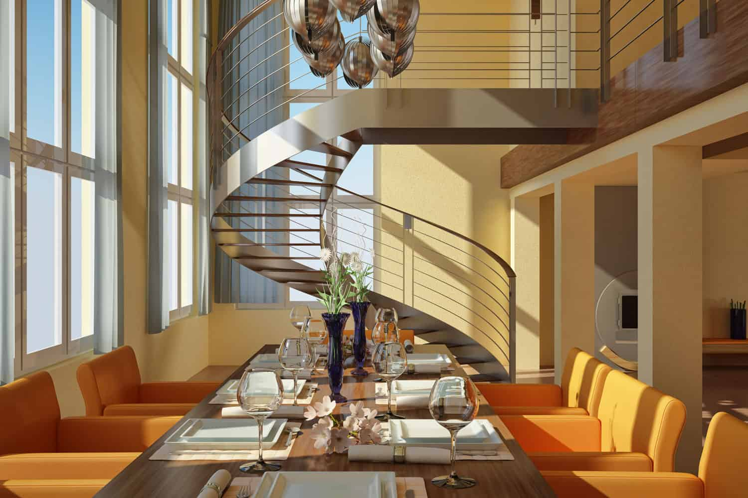 A metal spiral staircase inside an open space dining area