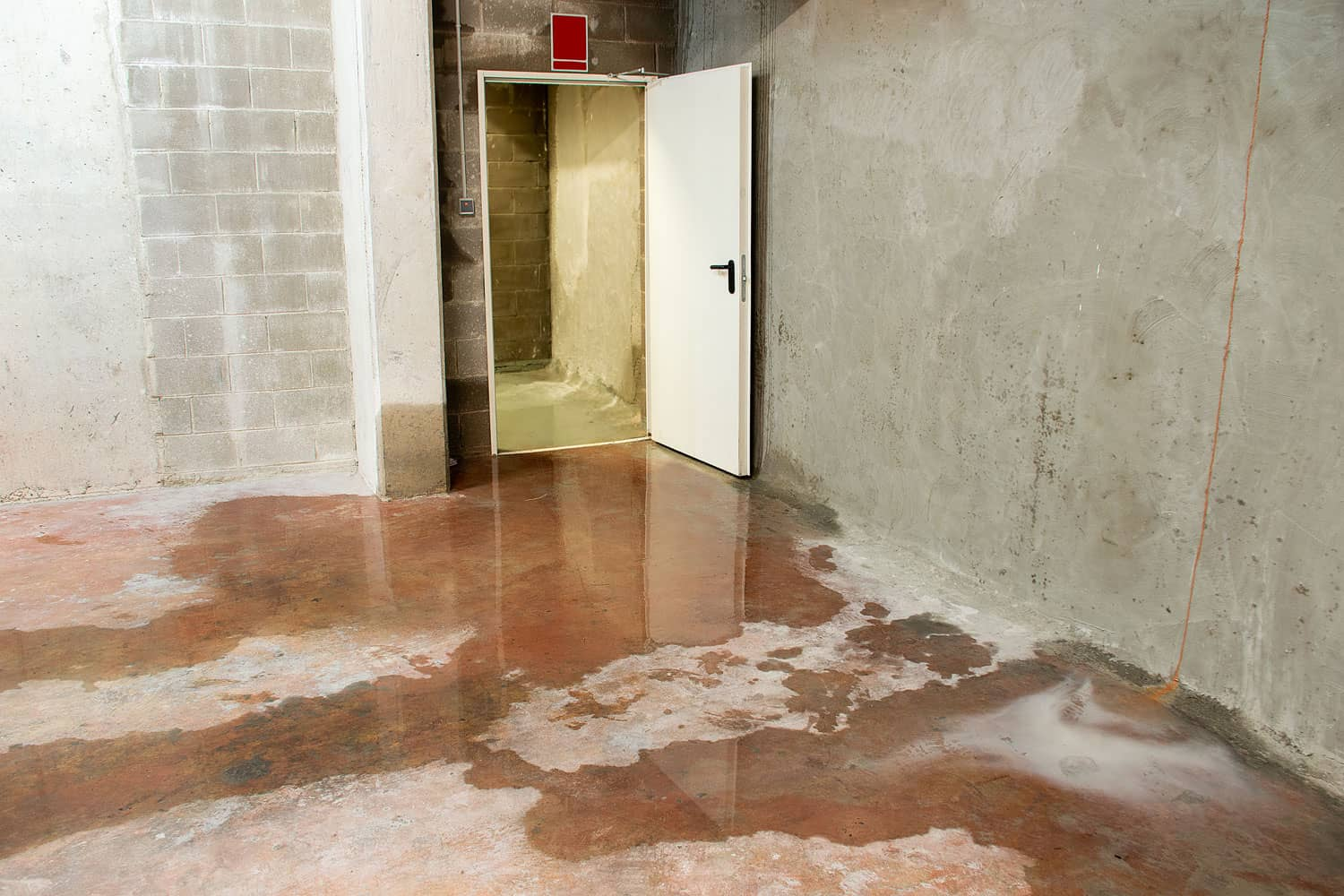 A wet basement due to leaking on the walls