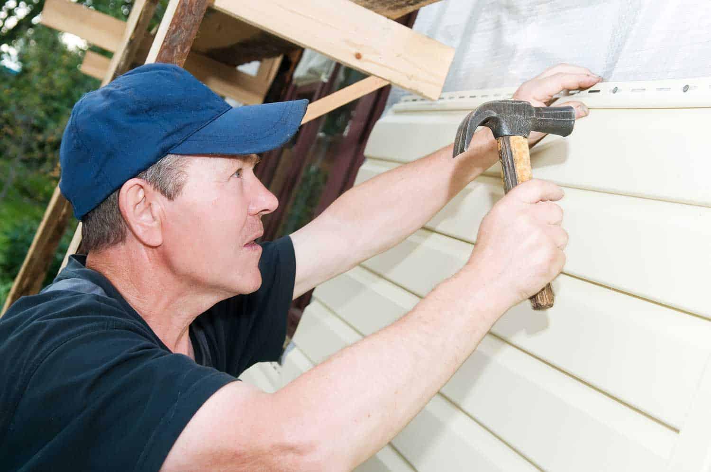Carpenter doing house siding works