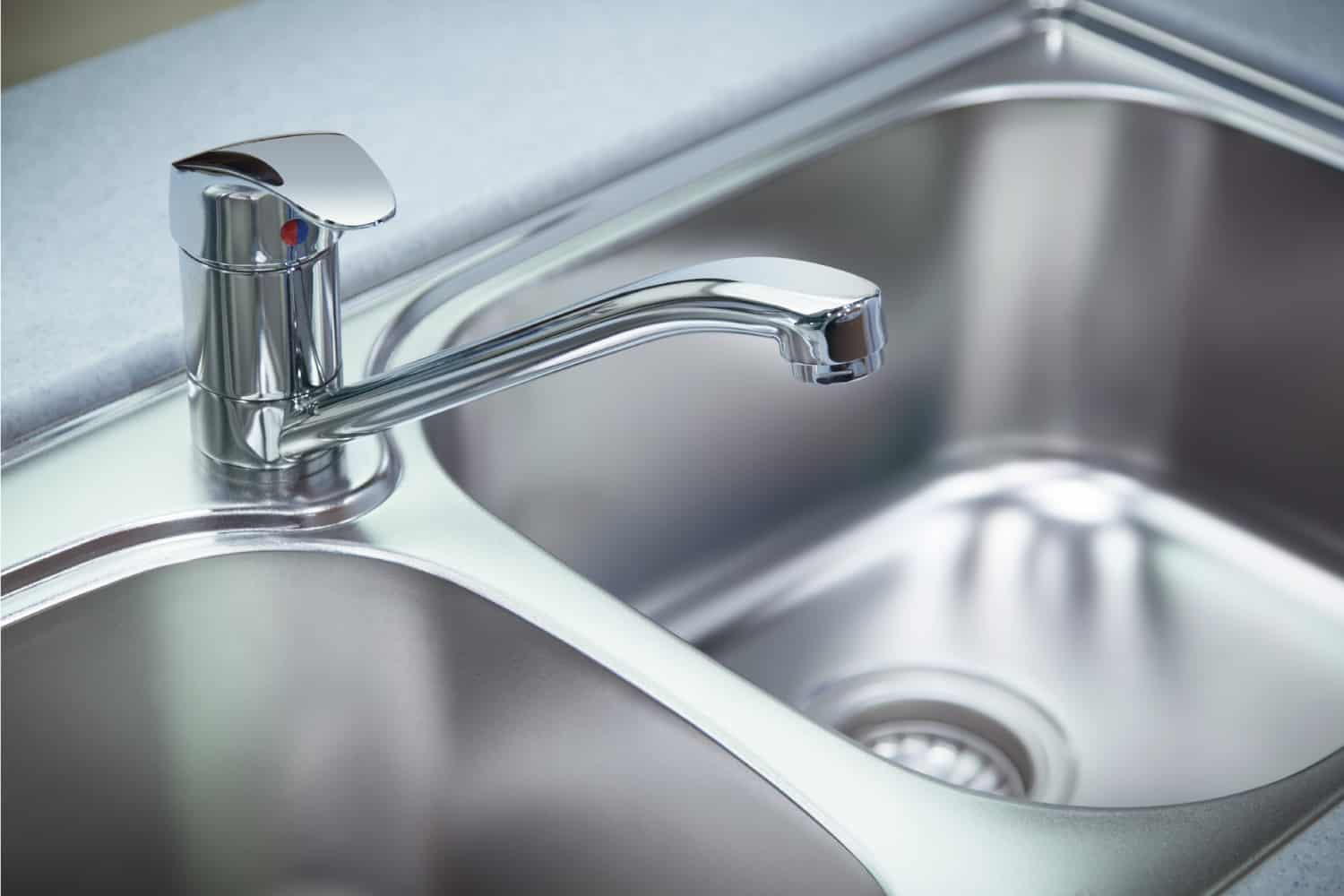 Clean chrome tap and stainless steel kitchen sinks