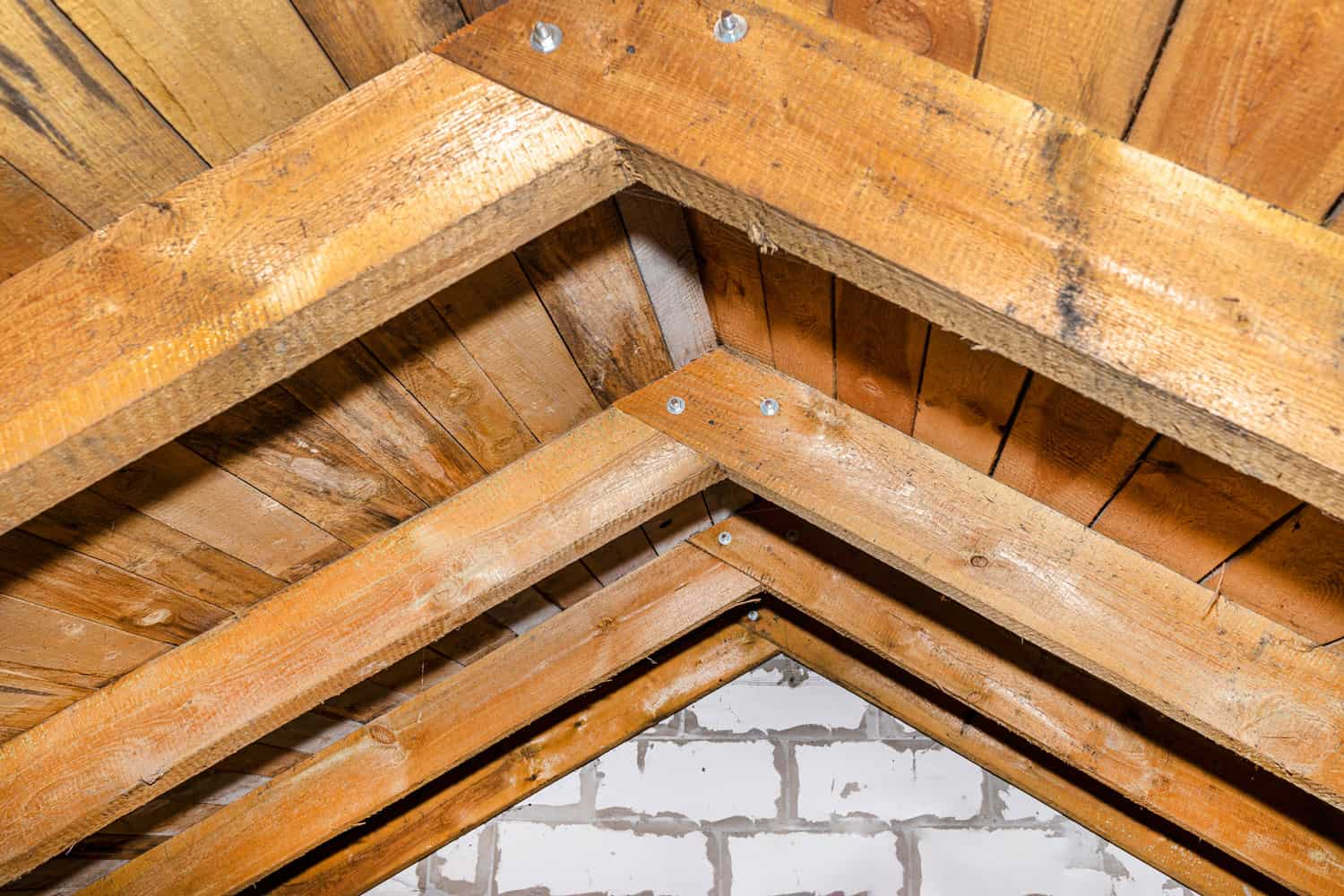 Wooden roof made of rafter-type roof truss, close-up view from the inside
