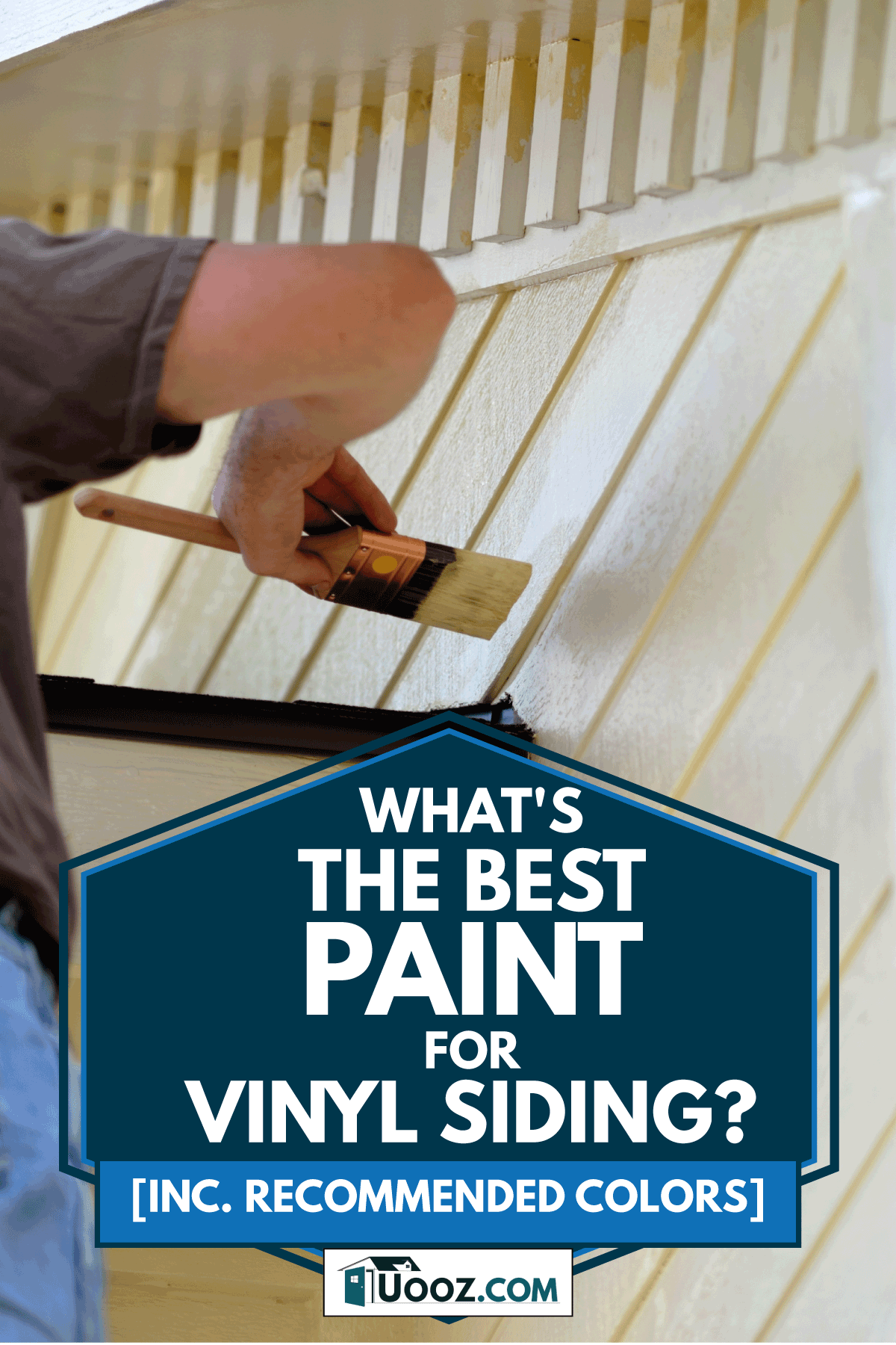 Worker uses a small brush to hand paint siding of a house, What's The Best Paint For Vinyl Siding? [Inc. Recommended Colors]