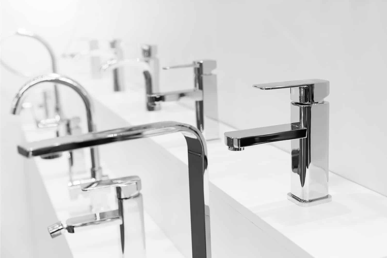 Store stand with assorted bathroom faucets