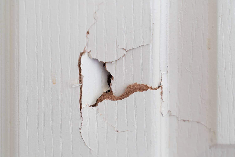 A broken hole in a door
