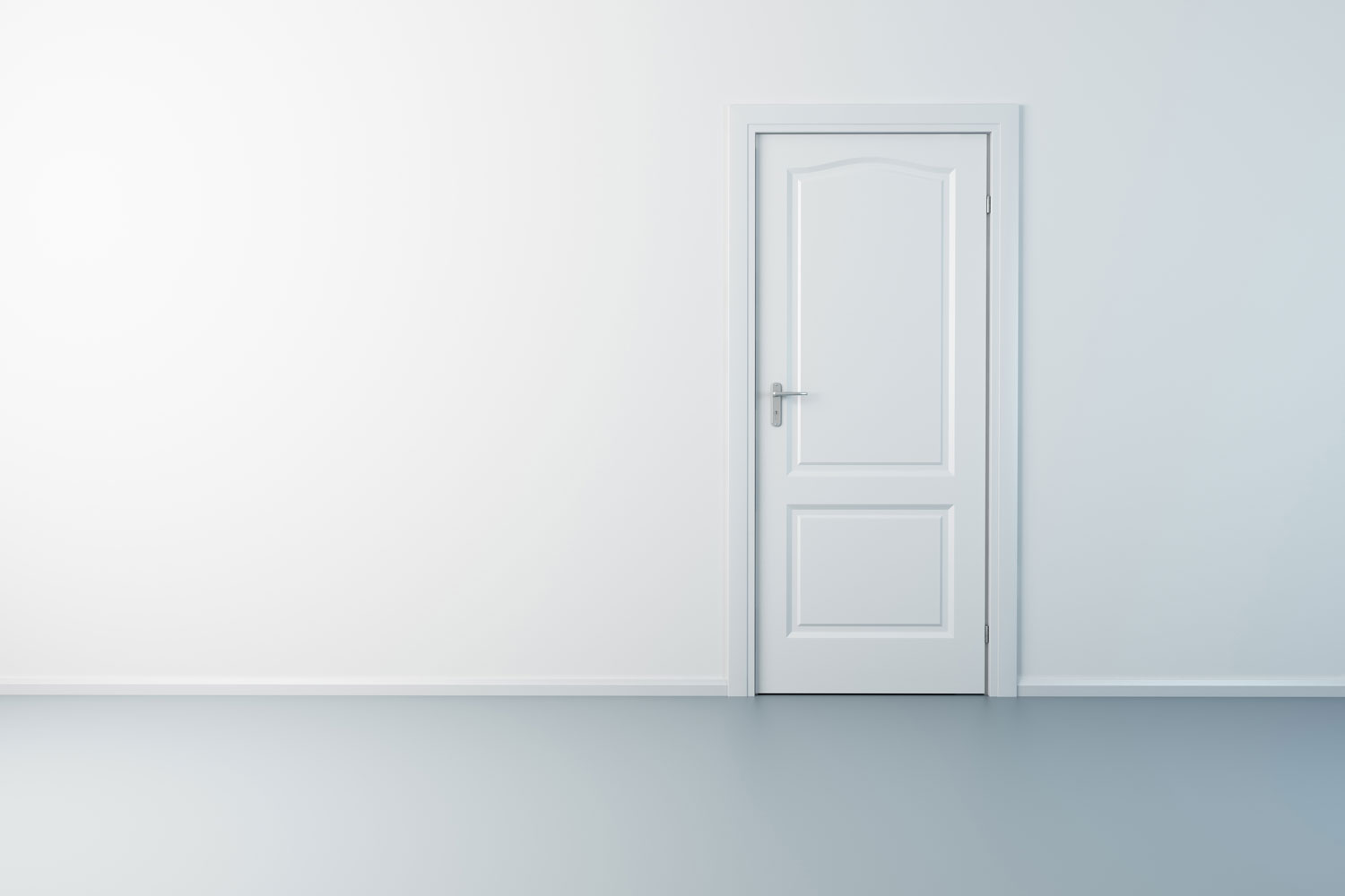 A white painted door inside an empty living room