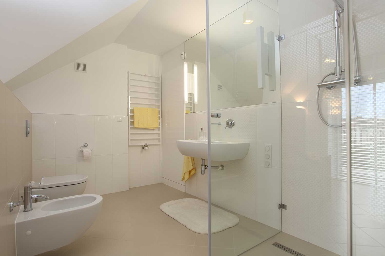 Attic white bathroom interior