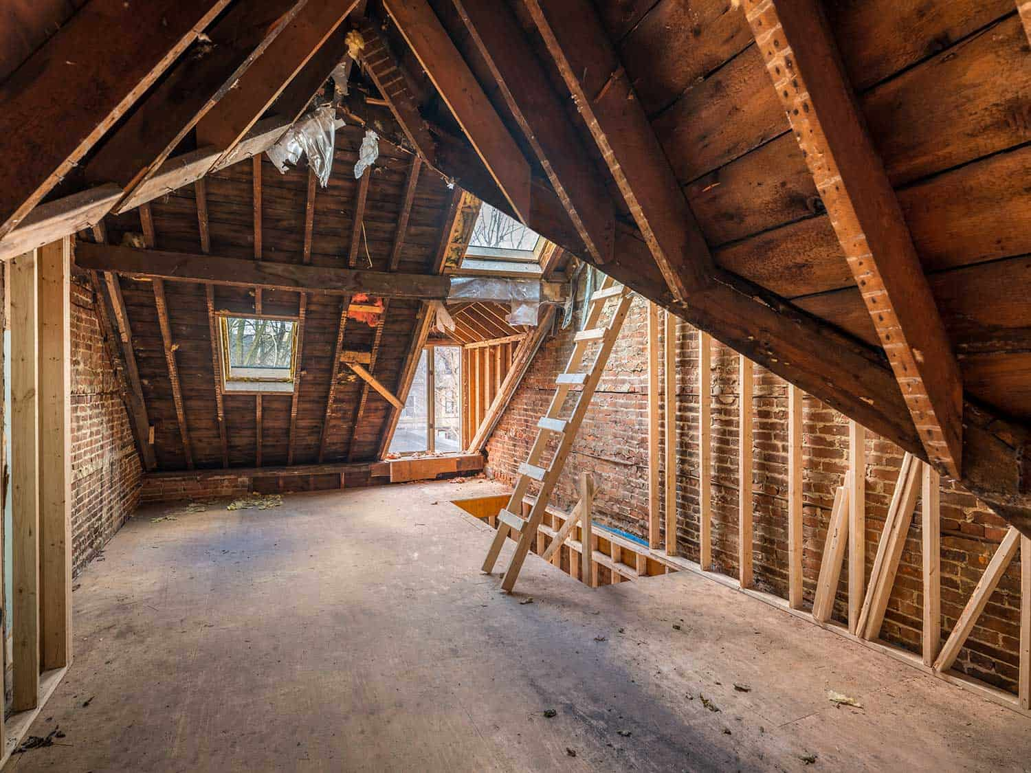 Interior of old Victorian style house under renovation, attic floor with exposed roof