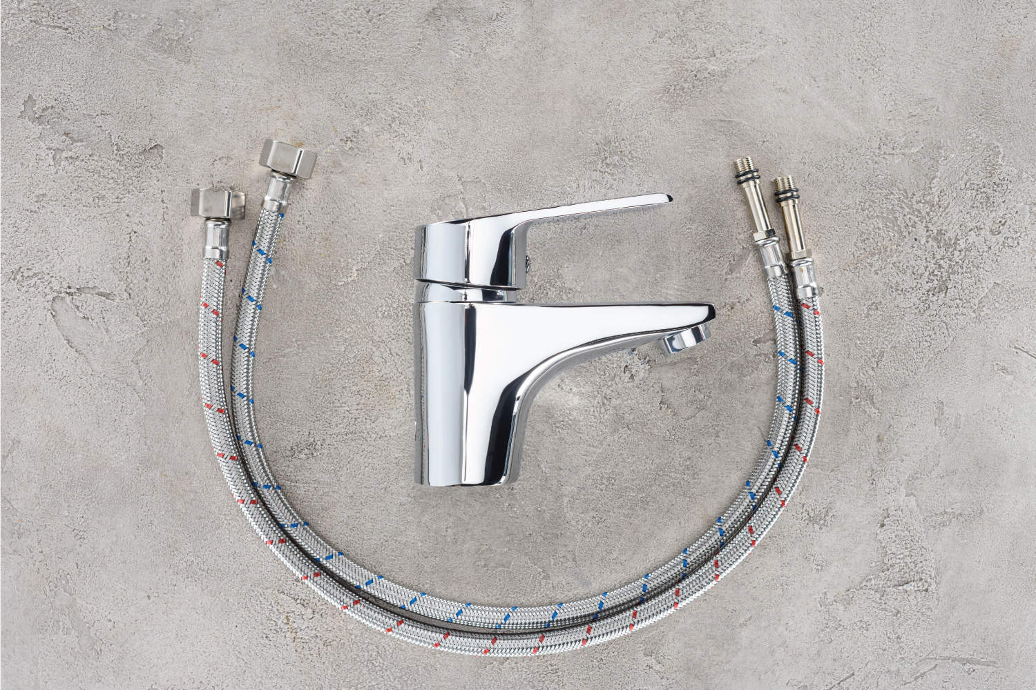 Top view of water blender with flexible pipes on concrete surface