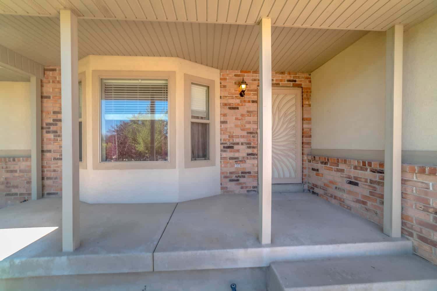 A modern front porch with decorative red brick design