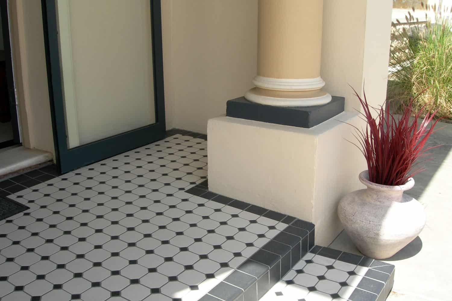 An entryway of a small contemporary house with a tiled front porch