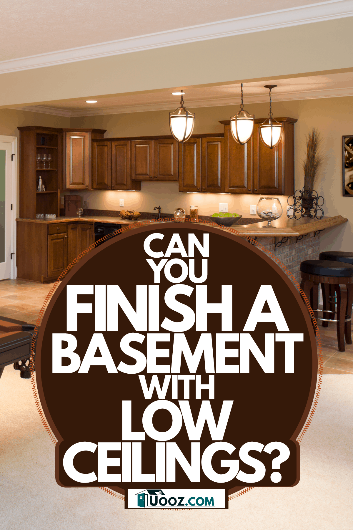 Interior of a basement with an entertainment area, a billiard table, and elegant dangling lights on the pantry area, Can You Finish A Basement With Low Ceilings?