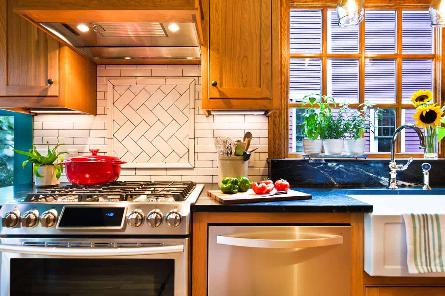 A contemporary classic kitchen renovation remodeling featuring a classic wood maple kitchen cabinet and black granite countertop
