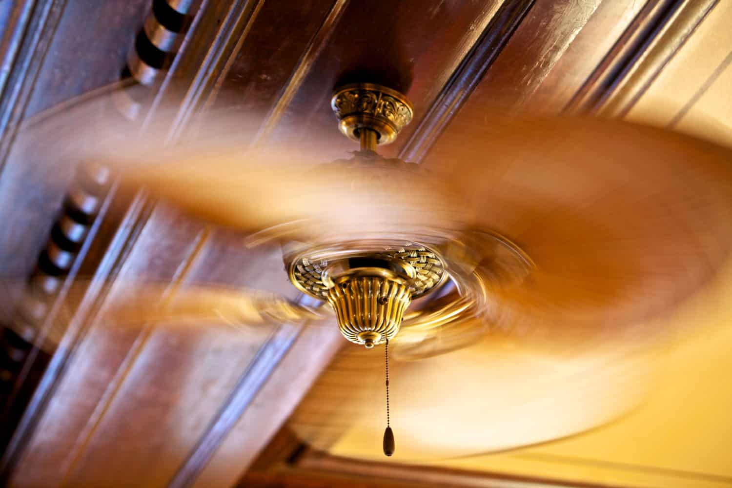 A wobbling ceiling fan photographed at high speeds