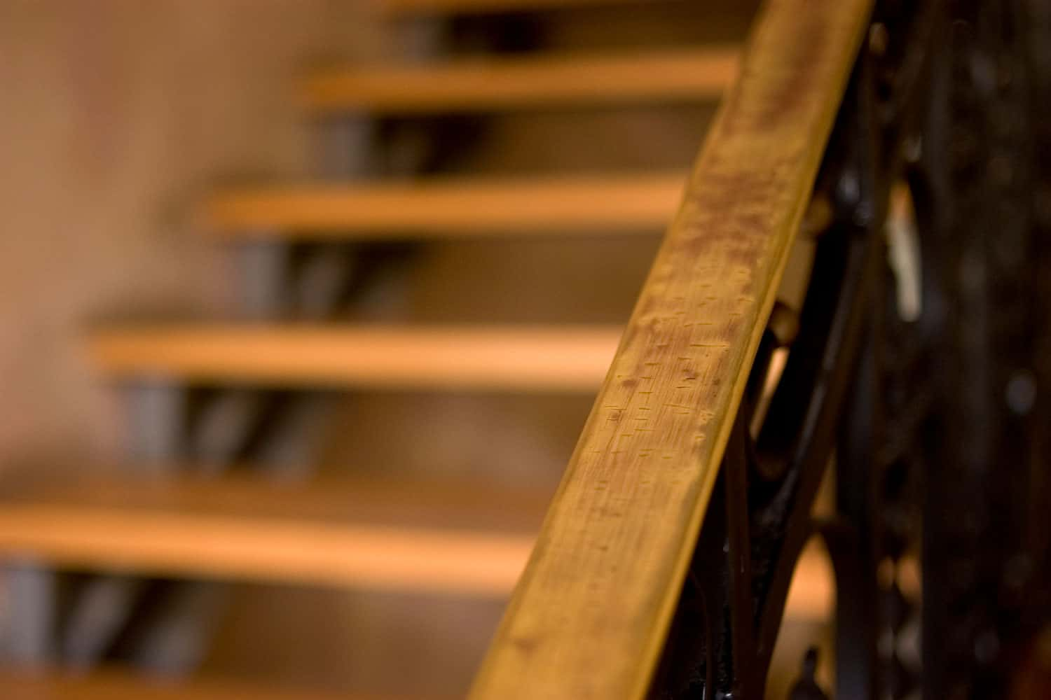 A wooden staircase with wooden railing