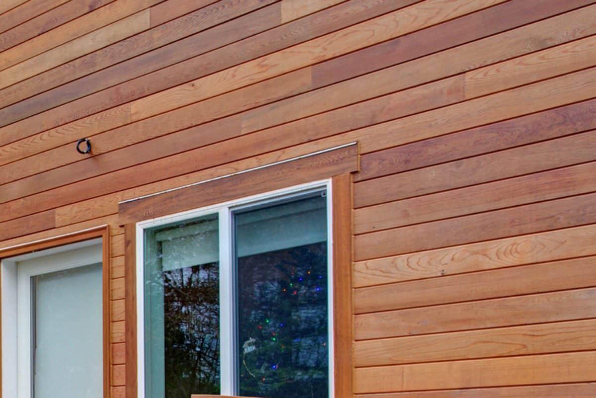Charming newly renovated home exterior, natural wood siding