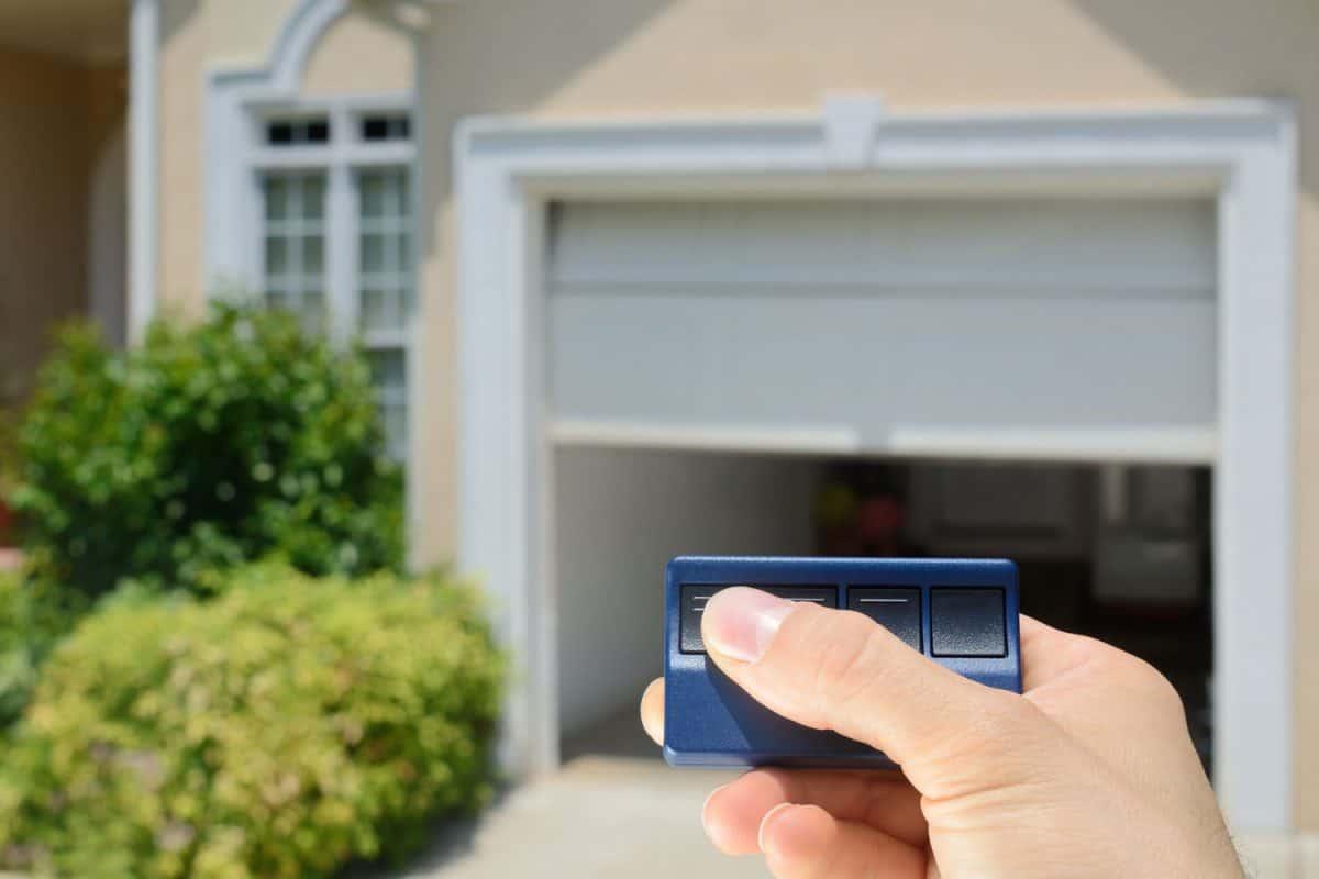 Garage Door Opener opening a residential garage door