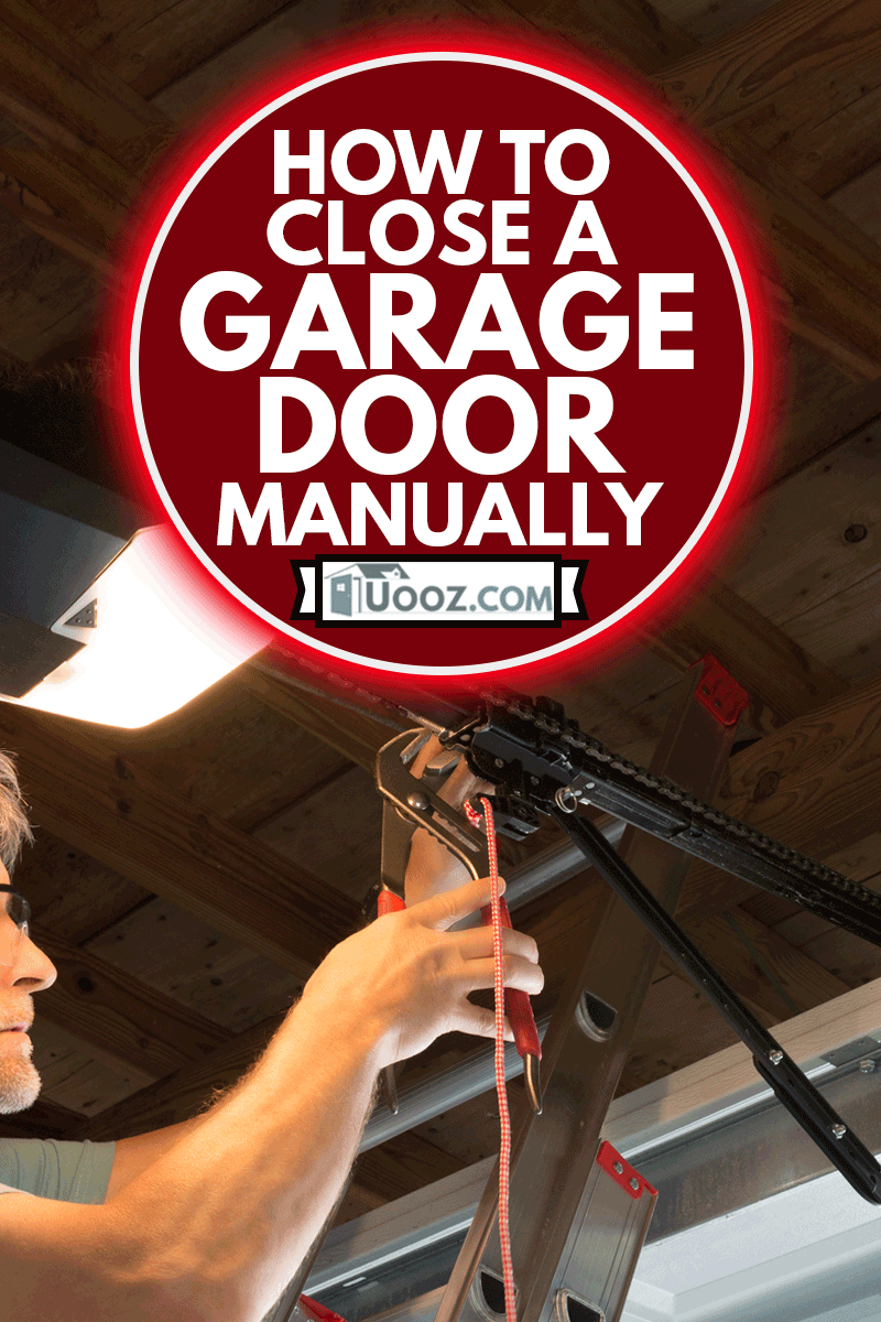 Closeup of a professional automatic garage door opener repair service technician man working on a ladder at a home residential location making adjustments and fixing it while installing it, How To Close A Garage Door Manually