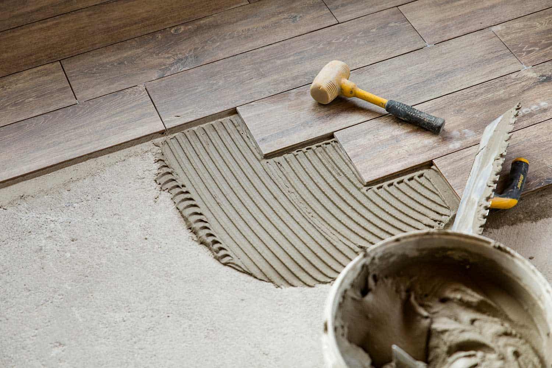 Installing hardwood tile walls on floor