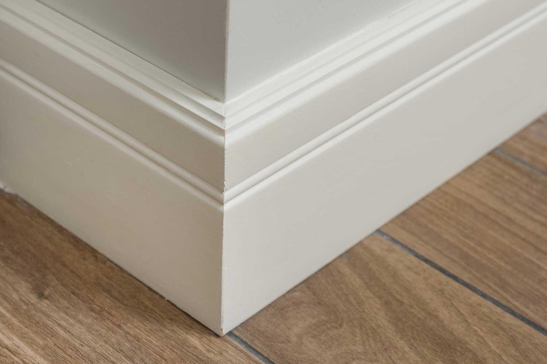 Light matte wall with tiles imitating hardwood flooring