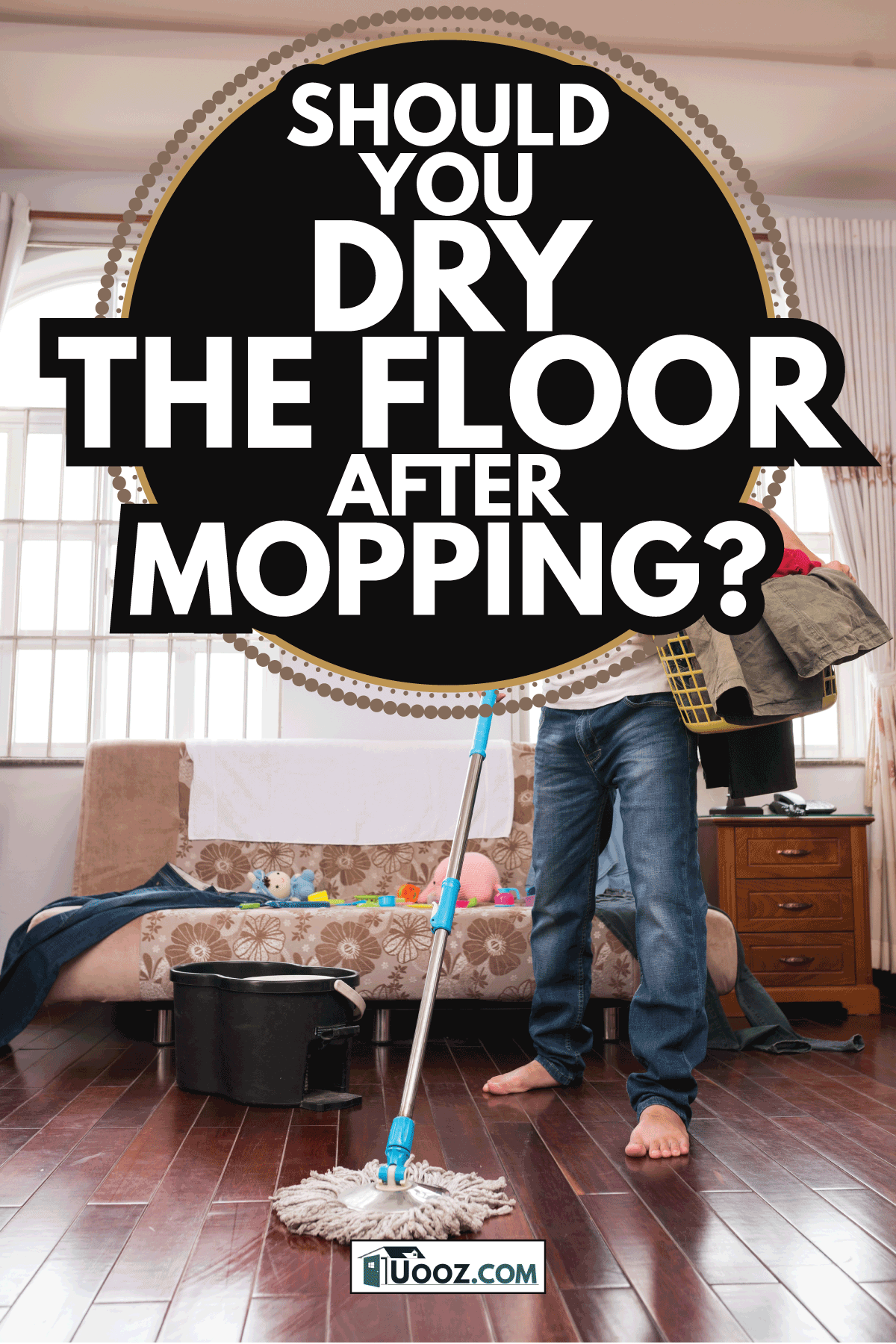Man mopping floor while holding clothes basket. Should You Dry The Floor After Mopping