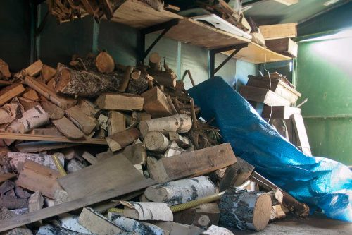 Should You Store Firewood In Your Garage?