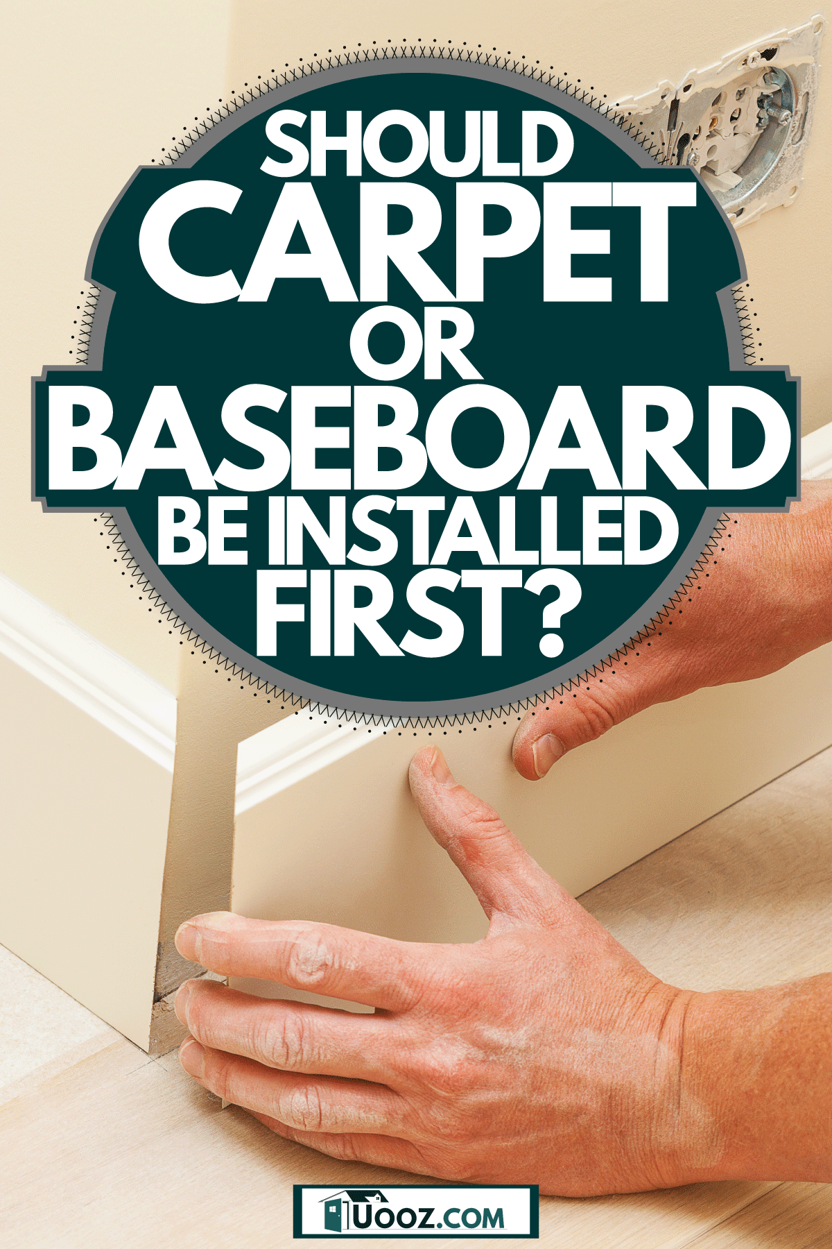 A man installing a white colored baseboard, Should Carpet Or Baseboards Be Installed First?